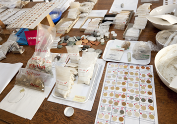 A desk with rock-samples and sample holders.